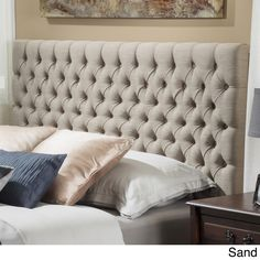 Dress up your bedroom with this elegantly designed headboard. This French inspired headboard is button diamond tufted and can attach to almost any queen or full metal frame bed, as well as adjust according to the height of your mattress.
