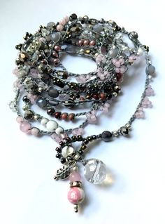 A personal favorite from my Etsy shop https://www.etsy.com/listing/537181573/pink-and-grey-crochet-bead-wrap-bracelet