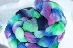 Water colors  https://www.etsy.com/listing/235209782/hand-dyed-merino-roving-purple-blue
