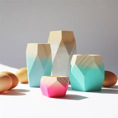 Geometric wooden candlestick holders with a gradation of white to cool pastels...
