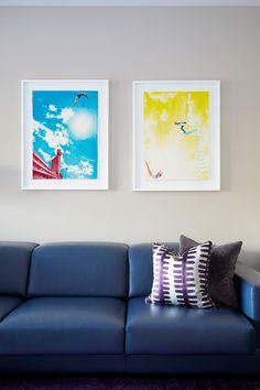 Colourful artwork against Elephants Breath wall colour by Farrow & Ball