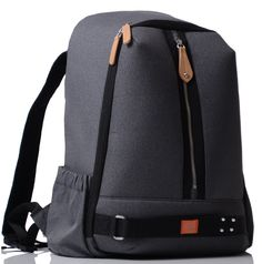 A black charcoal backpack baby changing bag with unisex appeal, clips onto your pram and has everything for you and your baby cleverly hidden inside the pod system