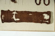 """Photo of the sprang stocking, or sleeve, from Tegle, Norway. It also has a tablet-woven border. Dated 3-5th c. in """"Prehistoric Textiles"""" by E.J.W. Barber."""