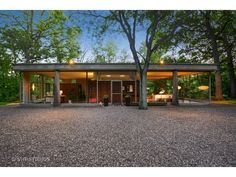 Just on the market, the incredible Glass House on a Bluff by H.P. Davis Rockwell.