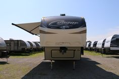 """FEEL REAL FREEDOM IN THIS FIFTH WHEEL!!!  2017 Keystone Cougar 326RDS Kick back in your spacious living area and relax with the 40"""" TV or lounge outdoors in the shade cast by your deluxe power awning! This 37' 8"""" long, 10462 lb. RV also includes an orthopedic sleep system so you can rest up from your full day of fun comfortably. XL pass-through storage included too!  Give our Cougar expert Steve Schuitema a call 231-903-6220 for pricing and more information."""