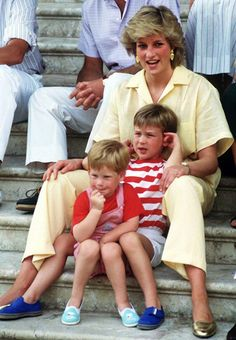 The brothers cuddle up to their mother Princess Diana on holidays in Spain in 1987.