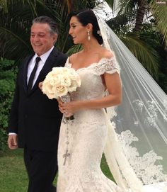 I absolutely love love love her bouquet with the big rosary -AC