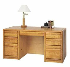 "Genuine Oak Office & Computer Furniture Series - 60""W Manager's Desk . $1029.00. All made of solid American red oak and oak veneer! 7-ply baltic birch drawer sides. Contemporary styling with radius edges, recessed drawer pulls and hand-crafted dado joint construction. Hand-rubbed medium oak lacquer finish. Ball-bearing full extension file drawers. Heavy metal European glides on box drawers. All file drawers accommodate letter/legal hanging files. Made in USA. Sh..."