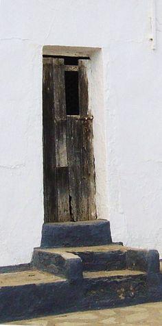 Old door with lots of character. Setenil de las bodegas, an amazing rock village in Cadiz (Andalusia, Spain)