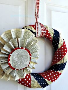 4th of July Book Page Wreath. A vintage patriotic wreath made from old book pages, and blue and red polka dot fabric. Really fun idea. http://hative.com/diy-patriotic-wreath-ideas-for-4th-of-july-or-memorial-day/