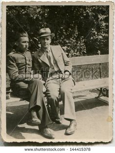 Ok, Well this is Poland 1934- but the guys suit is nice and wrinkled
