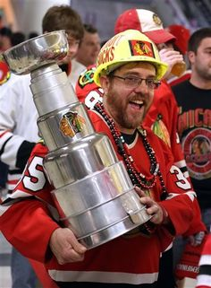 Ray Alcala, of Lisle, Ill. sports a homemade Stanley Cup after the Blackhawks defeated the Detroit Red Wings 2-1 in overtime in Game 7 of the NHL hockey Stanley Cup Western Conference semifinals Wedne