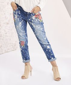 Dress for complete comfort and simple style in these cotton jeans that offer stretch-kissed construction and a floral embellishment for added appeal.