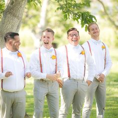 Salmon-hued suspenders add a pop of color to neutral groomsmen outfits.