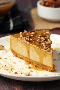 Deliciously rich and decadent vegan pumpkin cheesecake packed with flavor and topped with a caramel sauce and crushed pecans! Pumpkin Puree Recipes, Vegan Cheesecake, Cheesecake Desserts, Pumpkin Cheesecake Recipes, Raspberry Cheesecake, Vegan Pumpkin, Pumpkin Oatmeal, Pumpkin Pumpkin, Healthy Pumpkin