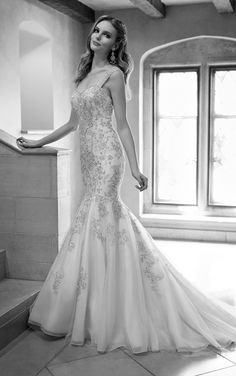 Dropped waist wedding dress with beaded silver Lace and Royal Organza over Dolce Satin fit-and-flare with a sweetheart neckline and cap sleeves.