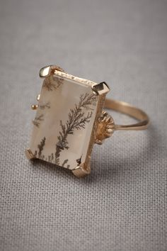 """Microcosm Ring - Like tiny trees, fractal patterns frozen in quartz crystal create an otherworldly ambiance encased in bright gold. From Christina Zazo. 0.75""""L, 0.5""""W stone. 18k gold plated brass, dendrite quartz. Handmade in Spain."""