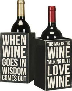 """This festive wood wine box has two fun wine sayings. It is a great way to display your wine! Captions read: THIS MAY BE THE WINE TALKING BUT I LOVE WINE WHEN WINE GOES IN WISDOM COMES OUT SIZE: 4.25"""""""