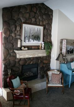 Fireplace Makeover - stained river rock and painted and distressed mantel   Read Between Designs