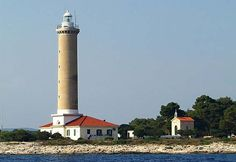 Veli Rat Lighthouse is an active lighthouse on the Croatian island of Dugi Otok, and is a well known landmark near to the village of the same name.    The singl... Get more information about the Veli Rat Lighthouse on Hostelman.com #attraction #Croatia #landmark #travel #destinations #tips #packing #ideas #budget #trips