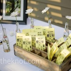 Kelly designed the escort cards to look like old-fashioned movie tickets. She and a bridesmaid printed them at Kinko's and spent an afternoon cutting them down to size. Kelly displayed the cards in an old soda-pop crate she and Jeff found in their Brookly...