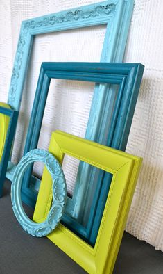 upcycled frames. teal turquoise lime I think I'd like a bright colored frame in my wall collage in the bedroom & dining room.