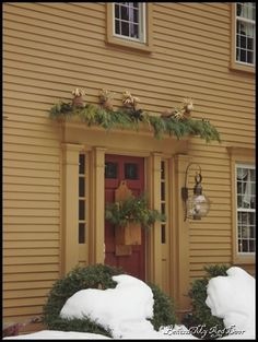 front door and box with evergreens.  simple.  pretty.