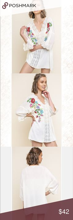 Floral Embroidered Cream V-Neck Tunic by UMGEE Cream colored tunic with floral embroidery, wide sleeve v-neck tunic and crochet trim detail.  100% rayon body, 100% cotton trim.  Dry clean only.  Gorgeous top by UMGEE. Umgee Tops Tunics