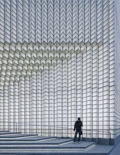 Facade of Shanghai boutique updated with pixellated grid of glowing glass.