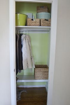 Low shelf in the coat closet?  To keep baskets, etc off the floor.  Ohh Baby!: Coat Closet Reveal!