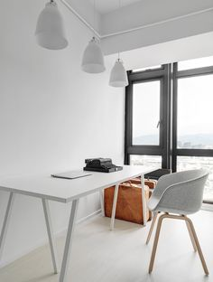 White workspace. Features with Lightyears Caravaggio Matt pendant light, HAY Loop Stand Table and About a Chair AAC23. Tai Tsai Residence by Tai & Architectural Design. Photo by Kyle Yu.