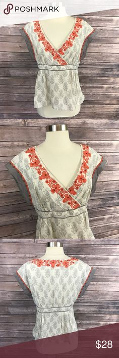 Floreat Top Gray Orange Embroidered Floral V Neck Floreat Anthropologie Top Size 8 Gray Orange Embroidered Floral V Neck Blouse. Measurements: (in inches) Underarm to underarm: 17 Length: 22.5  Good, gently used condition Anthropologie Tops Blouses