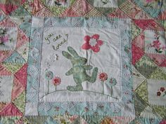 quilt made with a pattern from the Stonefields quilt, made from vintage embroidery and new fabric, by sylvia Extra