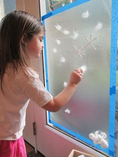 Sticky paper snow mural for preschool.