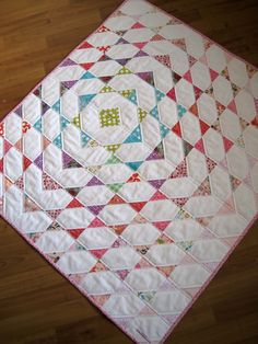 Baby Quilt - Disappearing Scraps This is stunning! I wouldn't have thought to off-center it but it's gorgeous like that.