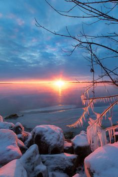 Sunrise by the freezing Ottawa River, Canada ~ by Dustin Abbott