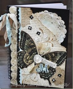 Yes... It's actually a journal cover. Beautiful. Love the butterfly and shabby look... neat tip: punch a circle out of glimmer paper and put it under the clear faceted button