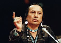 The 1970s was a turbulent time of confrontation and conflict, and Russell Means  perfectly fit that zeitgeist. To Native Americans who had endured centuries of oppression, the handsome, charismatic Oglala Sioux with the waist-length braids of black hair was a mash-up of Malcolm X, Abbie Hoffman and Saul Alinsky — a once-wayward soul who found a new purpose as a militant activist and who mixed physical confrontation with political theater.