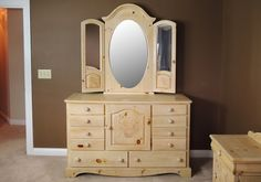 A lovely Vaughan Bassett country farmhouse style washed pine wooden dresser with mirror. Piece features delicate floral stenciling and a three panel, removable mirror with arched top. Pine Dresser, Dresser With Mirror, Large Drawers, Knobs And Pulls, Country Farmhouse, Stencils, Delicate, Flooring, Wood