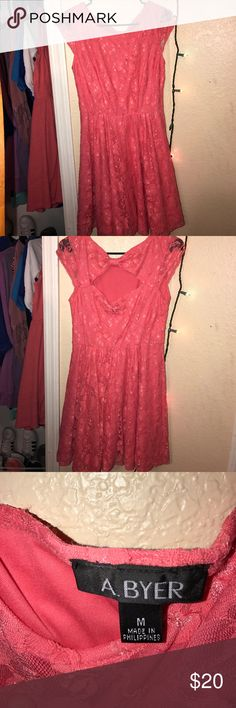 A Byer casual coral lace dress Beautiful coral lace dress that sits right above the knee, fantastic for any casual occasion and adds an exciting element with the bow design on the back A Byer Dresses