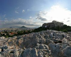 """Areopagus Hill is a historic hunk of rock found in Athens near the entrance to the Acropolis and just above the site of the Ancient Agora. Aereopagus in Athens was once a classical homicide court, a pre-classical meeting ground for city elders and the site where the Apostle Paul delivered his famous speech to the Athenians. The name of the rock remains unclear, but """"pagos"""" in Greek refers to a big rock, and it is thought that """"Areo"""" was derived from either Ares or the Erinyes."""