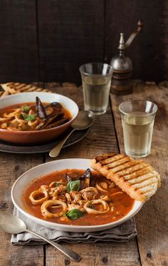 Zupppa di Pesce: Ingredients ― olive oil; onion; celery; garlic; white wine; tomatoes, puréed; chili flakes; brown sugar; dried oregano; salt & pepper; calamari; mussels; fish, cubed; seafood stock; basil; cream. Instructions ― Sauté onion & celery; add garlic & wine; cook; add stock, tomato, chili flakes, sugar, oregano, salt & pepper; simmer for 1 hour. Add calamari, mussels, and fish; simmer for 5 minutes; stir in cream & basil; simmer a few minutes; serve in bowls with toast. #Fish_Soup
