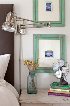 Shiny wall lamp? Blue mason and vintage fan? Chipped side table? Pictures taped inside painted frames???!!! Be still my heart.