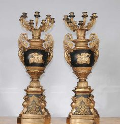 - Come view in our antiques showroom in Hertfordshire, just 25 mins north of London<br /> - At nearly three feet tall, this pair of French Empire style candelabras are very impressive<br /> - This is high Empire style with winged cherubim, angels, the griffin base and other arabesques and Empire motifs<br /> - Can you imagine how these would look with alighted candles?<br /> - Bought from a dealer at Les Puces flea market in Paris<br /> -...