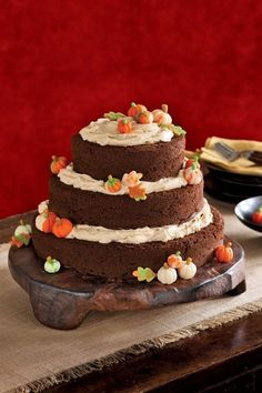 Layers of cake cushioned with pumpkin cream-cheese frosting create a lasting impression even before you take the first bite of this Pumpkin Spice Cake.