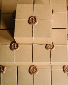 note: Boxes of saltwater taffy finished with anchors stamped in a gold wax seals—pure delight!