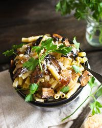 Ziti with Portobello Mushrooms, Caramelized Onions, and Goat Cheese | Meaty mushrooms are enhanced by sweet caramelized onions and just enough tangy melted goat cheese in this delicious year-round pasta.