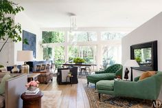 Chaise longues by Brenda Antin flank a Jillian Dempsey sculpture in the living room of Jillian and Patrick Dempsey's Malibu home.