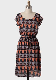 Quebec City Tie-waist Dress 42.99 at shopruche.com. This shimmery gray dress features a stylish navy and apricot geometric arrow pattern and a high-low cut. Finished with a removable, matching self-belt and an elastic waistband for a flattering silhouette. Fully lined skirt.100% Polyester, Made in USA,...