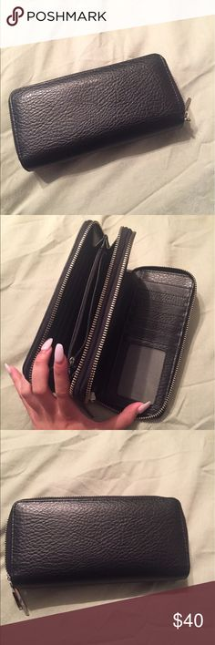 Matt & Nat black vegan leather wallet Used but in excellent condition! No flaws. Authentic from the Matt & Nat website. I've used it but it's extremely durable and has no signs of wear. Great for people who are looking into vegan brands. Double zipper with coin compartment and card slots Matt & Nat Bags Wallets